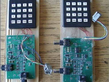 Lawrence Foltzer's frequency-domain test instruments. An Analog Devices AD9834-based RFG is on the left. An AD5930-based SFG is on the right. The ICSP interface used to program a Microchip Technology PIC16F627A microcontroller is provided by a dangling RJ connector socket. (Source: L. Foltzer, CC254)