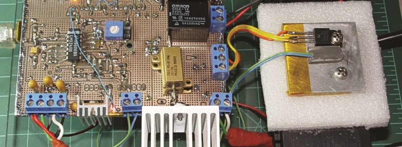 The MOSFET tester PCB hides the Arduino that runs the control program and communicates through the USB cable on the left edge. (Source: E. Nisley, CC265)