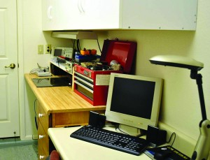 Photo 1: Boman's workbench includes overhead cabinets to help reduce clutter. The computer in the foreground is his web server and main home-automation system controller. (Source: D. Boman)