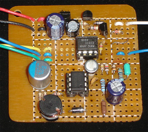 The base unit including the 5-to-15-V power supply is simple for its functionality. The two eight-pin DIP ICs are a voltage comparator and the switching regulator.