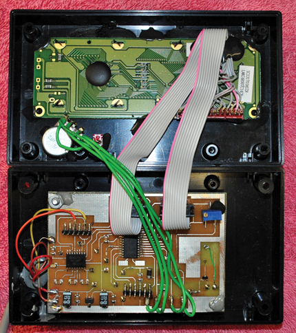 The display unit's completed assembly is shown with the enclosure opened. The board on top is the LCD's rear view. The board on bottom is the display unit board.