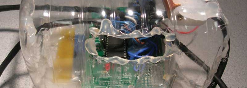 This is the central control belt-pack to be worn by a dancer for CUMotive, the wearable accelerometer project. An Atmel ATmega644V and an AT86RF230 were used inside to interface to synthesizer. The plastic enclosure has holes for the belt to attach to a dancer. Wires connect to accelerometers, which are worn on the dancer's limbs.