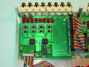 Photo 2: The crosspoint board shows the RCA input jacks (top), ribbon cable connections to the quad preamplifiers (right), and control and power cable from the CPU (bottom). Rev0 has a few black wires (lower center).