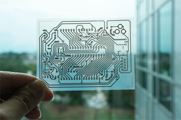 This single-sided wiring pattern for an Arduino microcontroller was printed on a transparent sheet of coated PET film, (Photo courtesy of Georgia Technical Institute)