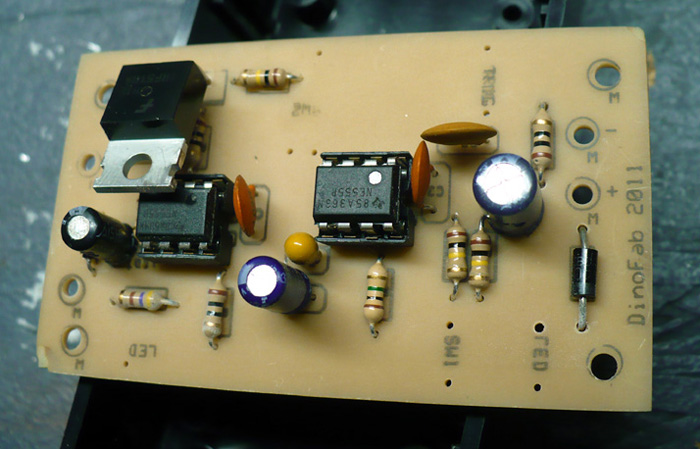 This is a homebrew PCB for Dino's fuel injector tester. Two 555s drive a MOSFET that switches the injector.