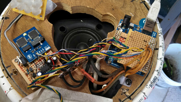 Photon's brain includes two Arduinos and an LM386 0.5-W audio amplifier with a sound-to-voltage circuit added to drive the mouth LED array. Photon's voice comes from a Parallax Emic 2 text-to-speech module.