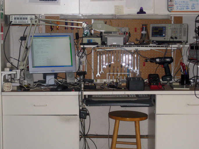 Instruments in Jerry's lab include a waveform generator, a digital storage oscilloscope, a digital multimeter, a couple of power supplies, and a soldering station.
