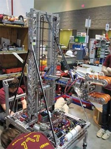 "A FIRST team member works on a robot ""in the pits"" at the 2011 Hartford, CT, regional competition."