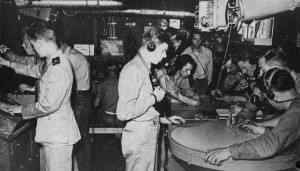 This is the combat information center aboard a World War II destroyer with two radar displays.