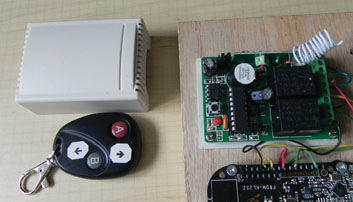 Photo 3: The two-channel wireless remote control is shown with the cover removed from the receiver. It came with two keychain-style remotes, which I marked with Up and Down arrows.