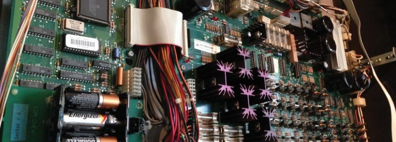 Quinn is in the process of hacking a Bally/Williams Johnny Mnemonic pinball machine. This photo shows the machine's circuitry.