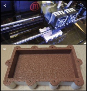 Robert Lacoste shows the 3-D printer (a) he used to build an acrylonitrile butadiene styrene (ABS) shield (b).
