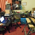 Hiew's workspace features component storage, a soldering station, power supply, and more