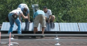 Team installing solar panels on Steve Ciarcia's roof