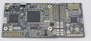 Photo 1: This shows the ChipWhisperer-Lite, which contains a Xilinx Spartan 6 LX9 FPGA and Atmel SAM3U2C microcontroller. The remaining circuitry involves the power supplies, ADC, analog processing, and a development device which the user programs with some cryptographic algorithm they are analyzing.