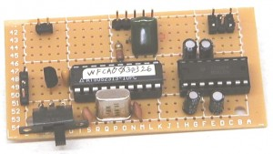Photo 1—The only components added to the operating Atmel AT90S2313 circuit needed to allow for waveform sampling with less than 1-μs resolution at 1-V full scale are the capacitor and two resistors. Imagine how small the circuit will be using surface-mount components.