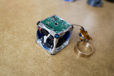 A prototype of the new modular robot, with its flywheel exposed. (Photo: M. Scott Brauer)