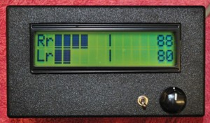 Figure 1—The Trailer Monitoring System consists of the display unit and a remote data unit (RDU) mounted in the trailer. The top bar graph shows the right rear axle vibration level and the lower bar graph is for left rear axle. Numbers on the right are the axle temperatures. The vertical bar to the right of the bar graph is the driver-selected vibration audio alarm threshold. Placing the toggle switch in the other position  displays the front axle data.