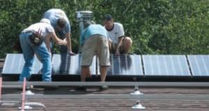 Team installing solar panels on Steve Ciarcia's roof
